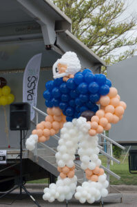 balloon decor - 13' tall balloon sculpture Football Player created for sports event