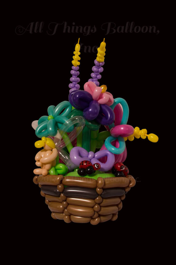 Balloon decor - balloon centerpiece - balloon basket with flowers, lady bugs, fairy, dragonfly