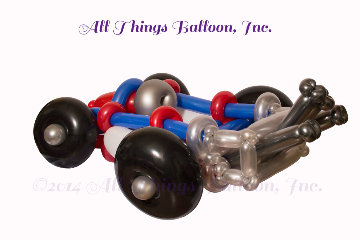 balloon artist - balloon race car built for kid's birthday party -- wearable