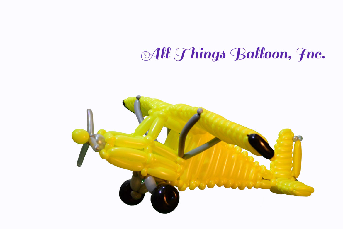 balloon artist- balloon Piper Cub airplane for kid's birthday party